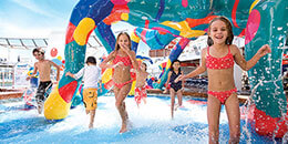 Kids in a splash pad on a cruise ship